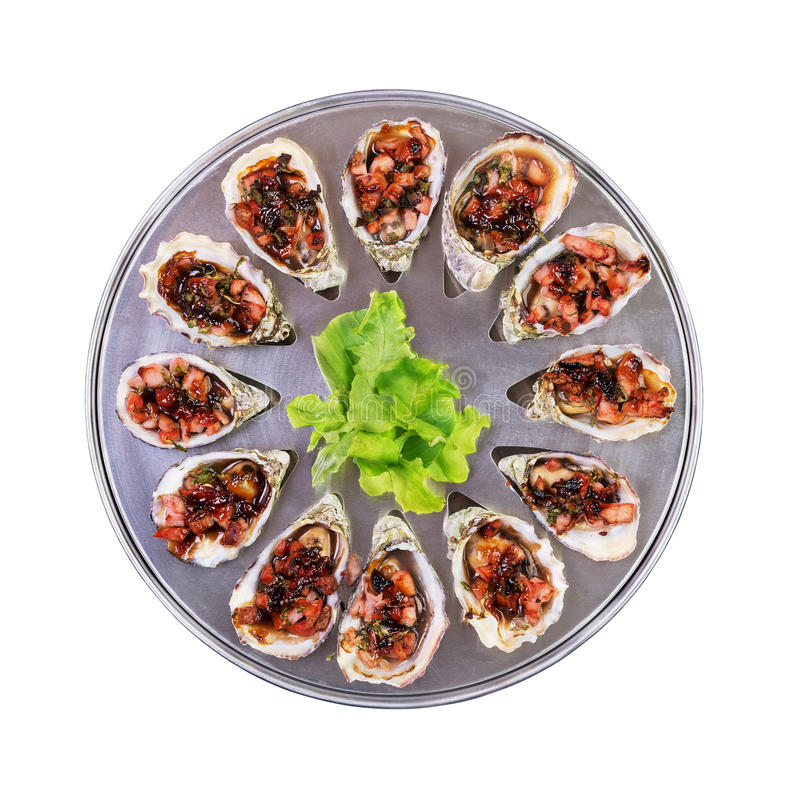 Dozen oven baked oysters kilpatrick isolated top view royalty free stock photo