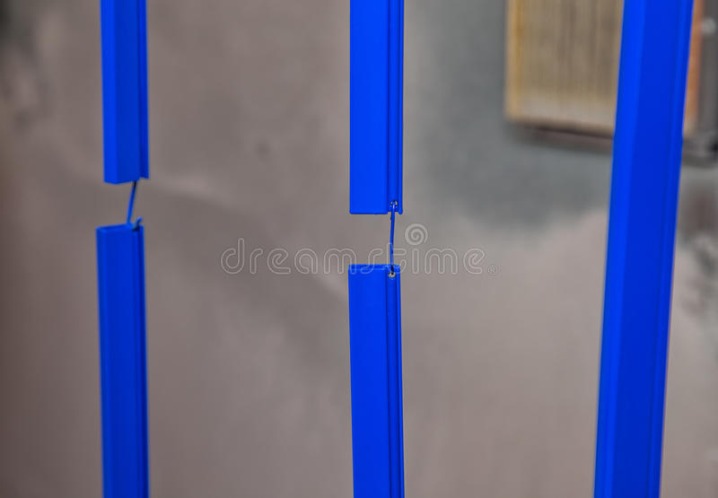 Drying of blue metal details. In workshop royalty free stock images