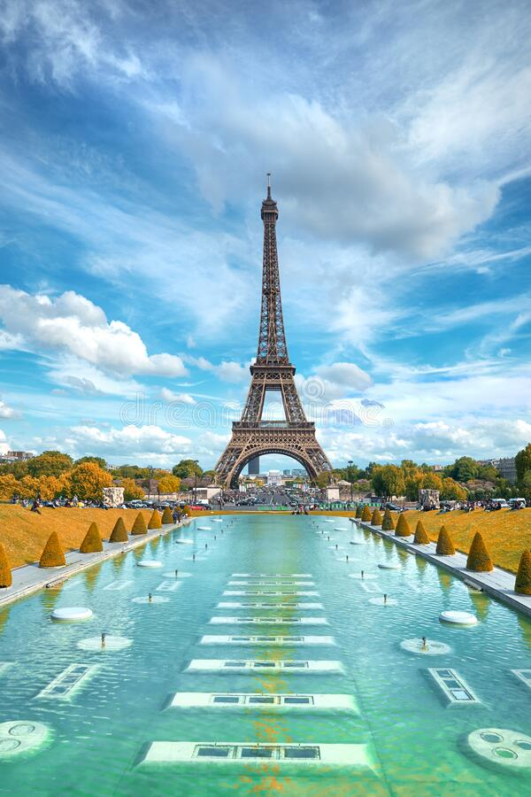 Eiffel tower, symmetrical front view from Trokadero on a bright day in Autumn royalty free stock photos