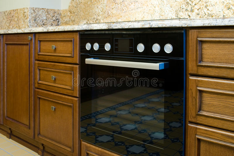 Electric oven in the kitchen. Electric oven in the modern kitchen royalty free stock photos