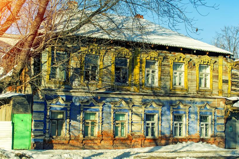 Facade of an old wooden house decorated with carvings in a traditional Russian style, blurred image royalty free stock photos