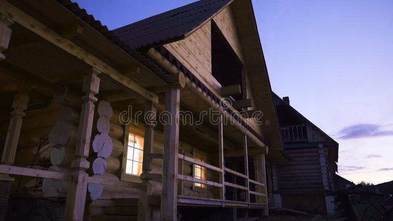 Facade of wooden cottage in Russian style. Stock footage. Bottom view of beautiful wooden cottage outside city in royalty free stock images