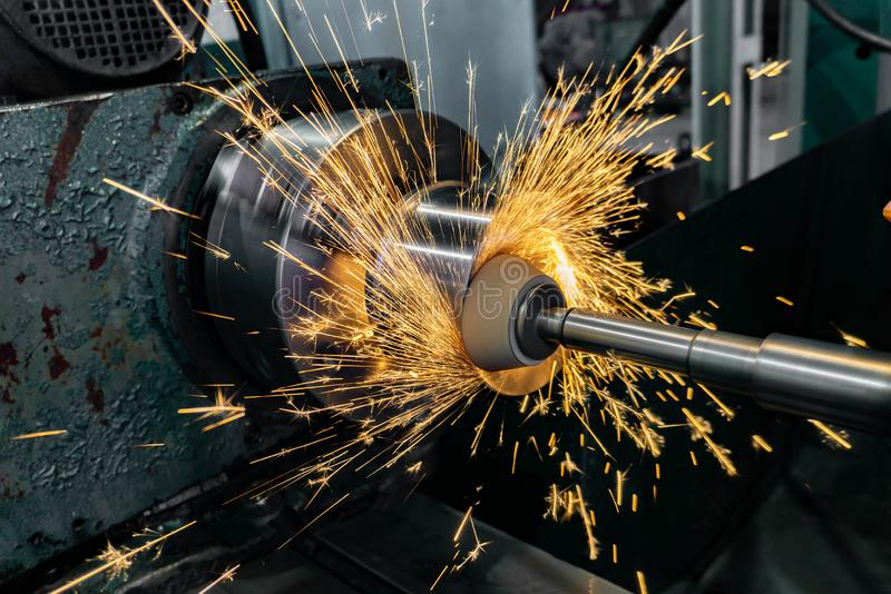 Face grinding with abrasive stone, high-precision finishing of the part with water cooling and sparks.  stock images