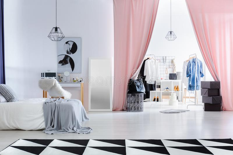Fashionable bedroom with dressing room royalty free stock photos