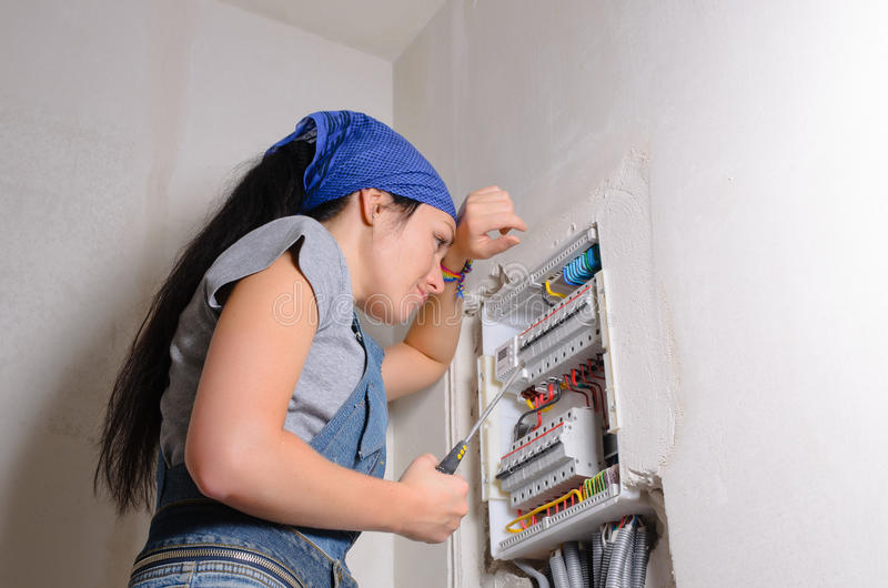 Female electrician with open fuse royalty free stock photos