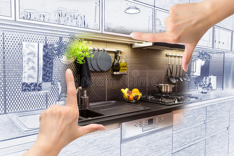 Female hands framing custom kitchen design. royalty free stock images