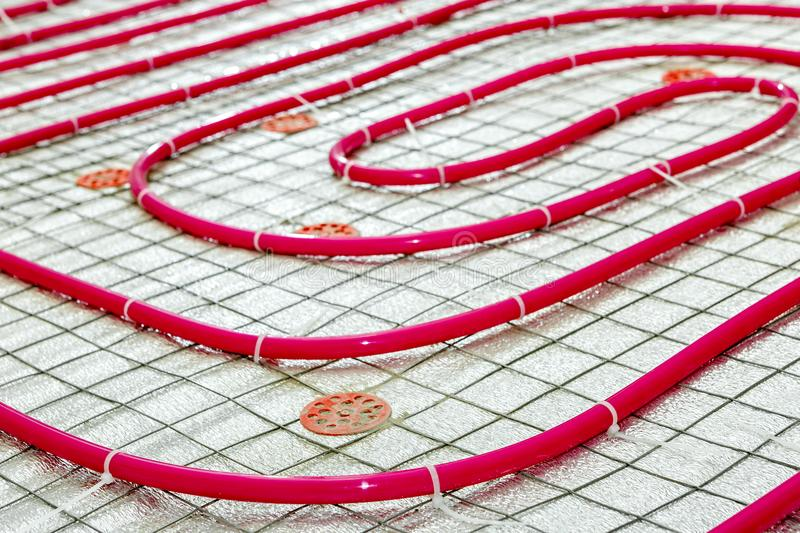 Floor heating pipe. Installation of engineering systems royalty free stock photos