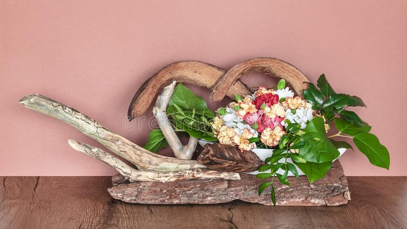 Floral Decoration on the Bark. Modern interior decoration stock image