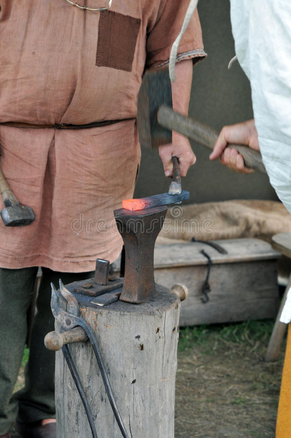Forging. On a middle ages market royalty free stock photo
