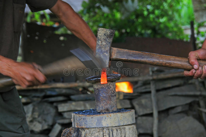 Blacksmiths forging tools. With hammers royalty free stock images