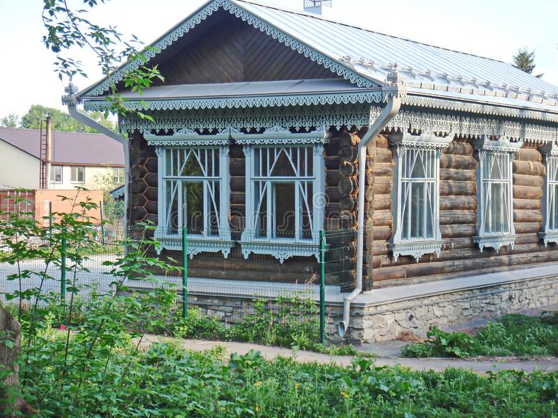 A fragment of the wooden facade hut. The window architraves. Folk art. Russian village. Old wooden houses. Monument of ancient Russian architecture stock images