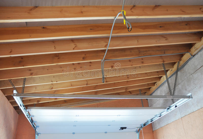 Garage Door Post Rail and Spring Installation Assembly and Garage Ceilling. The most important parts of assembly. Spring tension lifts garage door that the royalty free stock photo