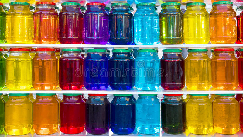 Glass jar with colored liquid stock image