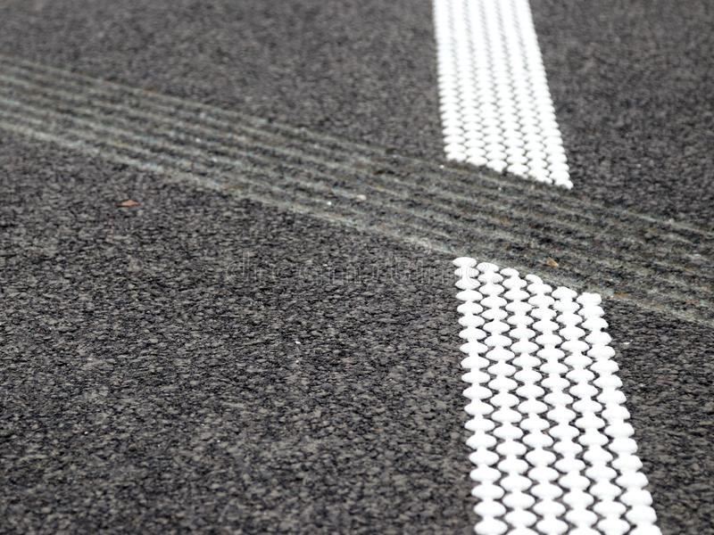 Grouting and hot plastic stripe on asphalt_2. White hot platic stripe on asphalt road royalty free stock photography