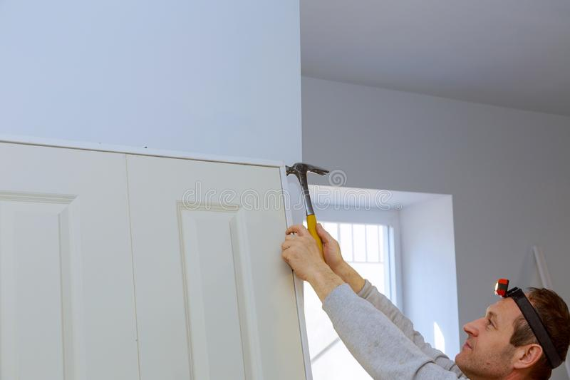 Handyman install the new twin door in the room. Handyman install the new twin door for interior in the room installation renovation assembling doorway house stock photography
