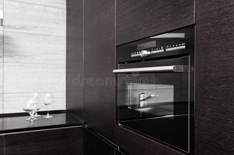 Hardwood kitchen with build-in microwave oven. Part of black hardwood kitchen with build-in microwave oven stock photography