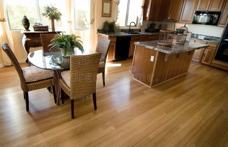 Home kitchen interior with hardwood flooring stock images