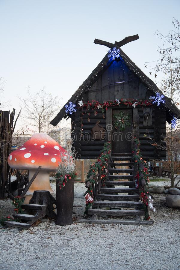 A hut made of dark wood. The hut of a character in Russian fairy tales. Baba Yaga`s House. The hut stands on chicken legs. Hut made of dark wood. Hut of a stock image