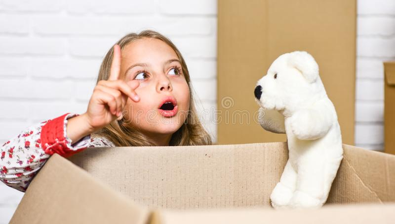 I have an idea. happy child cardboard box. happy little girl with toy. repair of room. new apartment. Cardboard boxes - royalty free stock photo