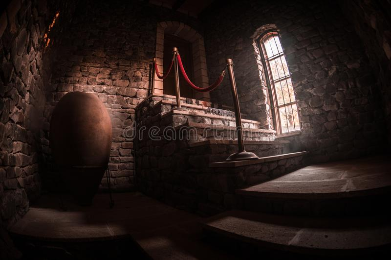 Inside of old creepy abandoned mansion. Staircase and colonnade. Dark castle stairs to the basement. Spooky dungeon stone stairs. In old castle. Horror stock photography