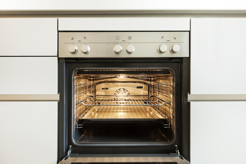 Inside of the oven. Modern kitchen, inside of the oven, open royalty free stock photo