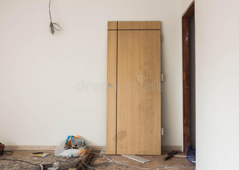Installation of door hinges. Construction,unfinished royalty free stock photo