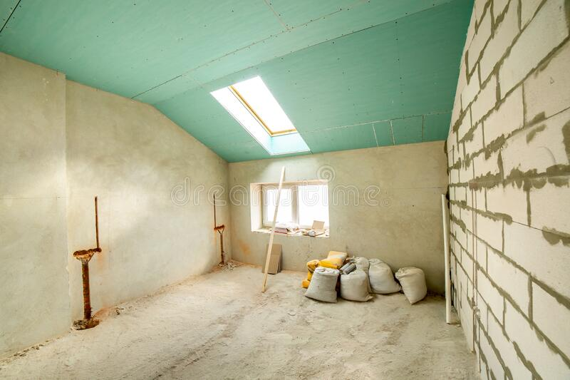 Interior of an apartment room with bare walls and ceiling under construction.  royalty free stock photos