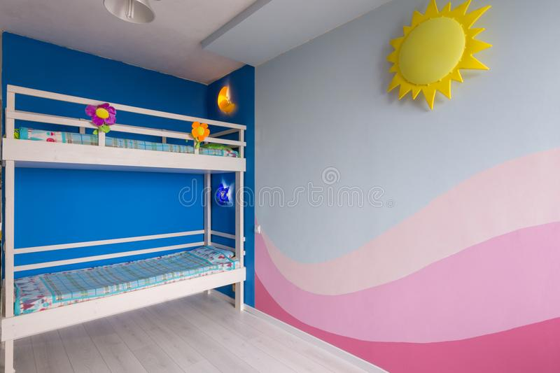 Interior of a children`s room for two girls after repair, painted wall and bunk bed royalty free stock image