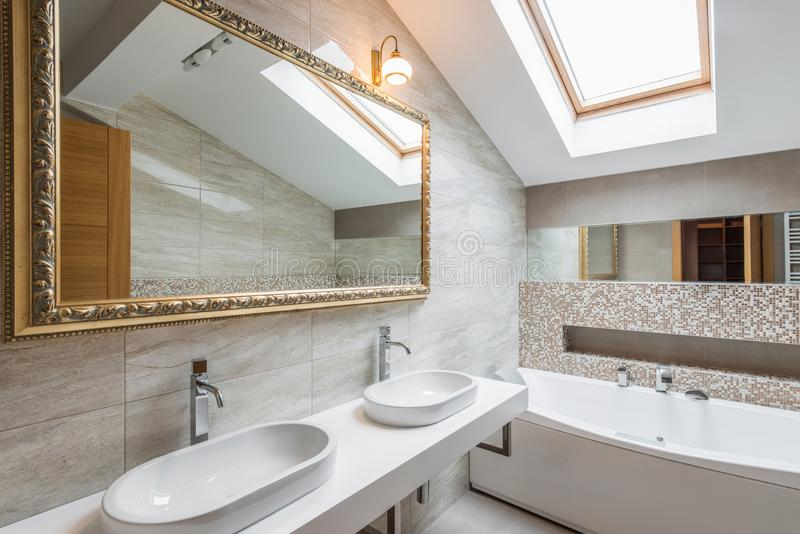 Interior of a luxury bathroom in loft apartment. Interior of a new luxury bathroom in loft apartment stock photo
