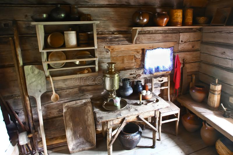 Interior of the Russian peasant hut. Kitchen interior, samovar, pots, kitchen utensils, oven stock images