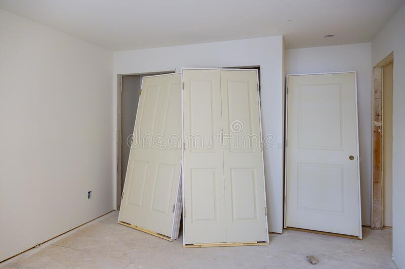 Interior wooden stacker door installation apartment building, wait installation for preparation of interior in new home. Interior wooden stacker door royalty free stock image