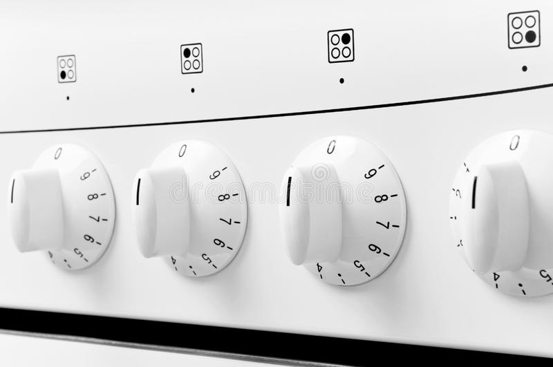 Kitchen baking oven. White kitchen baking oven buttons royalty free stock images
