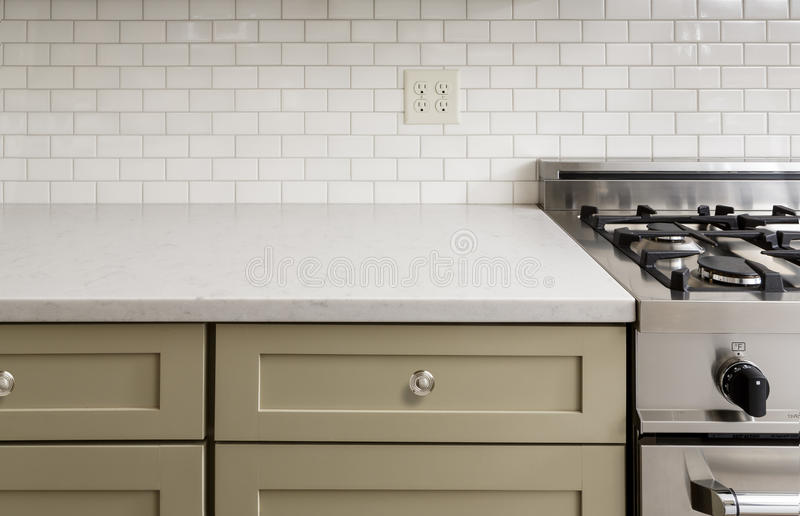 Kitchen Counter with Tile, Stainless Steel oven stove, Sh. Kitchen Counter with Subway Tile, Stainless Steel oven stove, Shaker Cabinets stock images