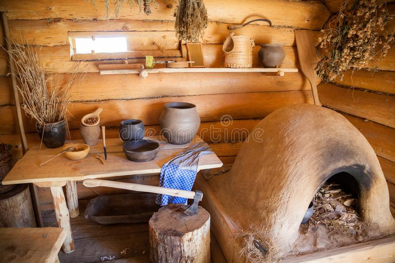 Kitchen in the old peasant log cabin royalty free stock images