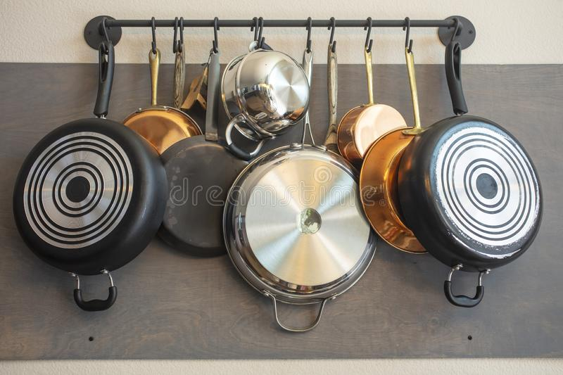 Kitchen wall rack for hanging pots, pans, aprons, and other utensils for storage and decor stock photo