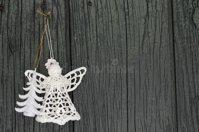 Knitted angel and xmas tree for christmas greetings card, and christmas royalty free stock photo