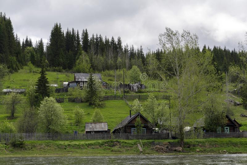 Typical Ural village on the river royalty free stock photography