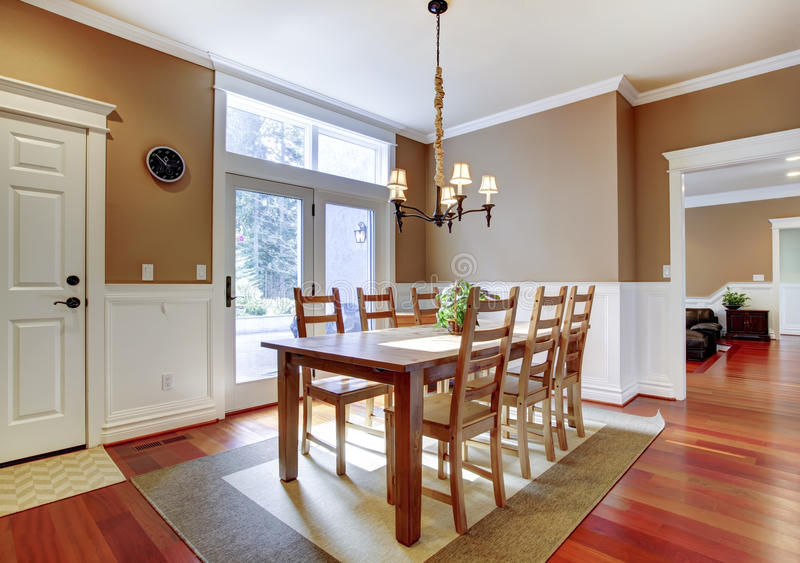Large bright beige dining room with cherry hardwood. stock photos