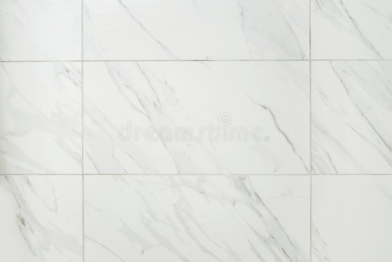 Large marble tile bathroom wall. Making a background stock photos