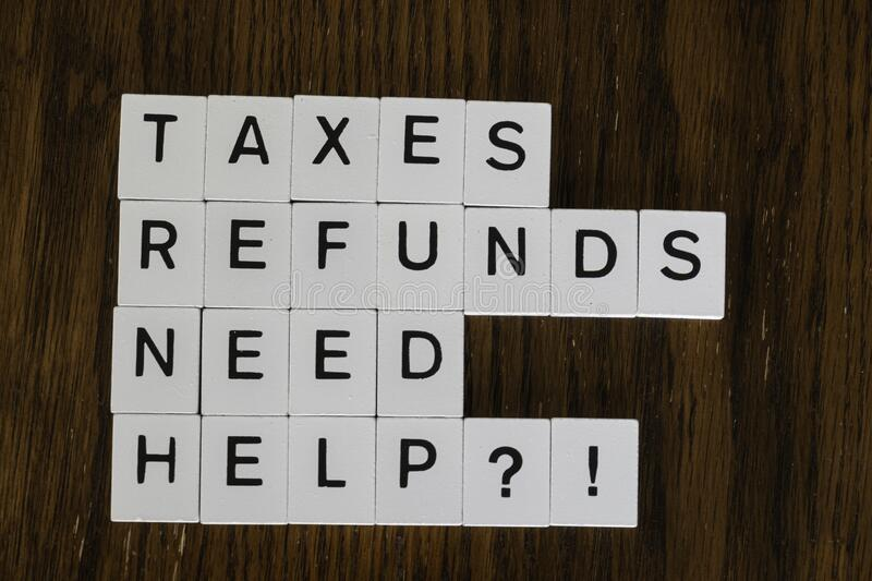 Letter tiles used to advertise tax preparation services. Financial Concepts stock images