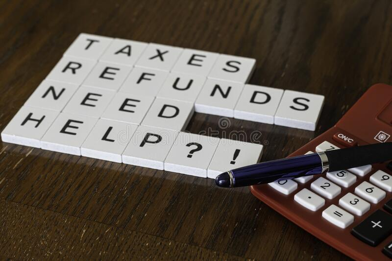 Letter tiles used to advertise tax preparation services. Financial Concepts royalty free stock photography
