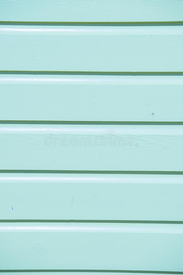 Light blue wooden clapboard. Closeup of bright empty wooden clapboard textured siding painted in light blue color with horizontal lines and nobody, copy space royalty free stock image