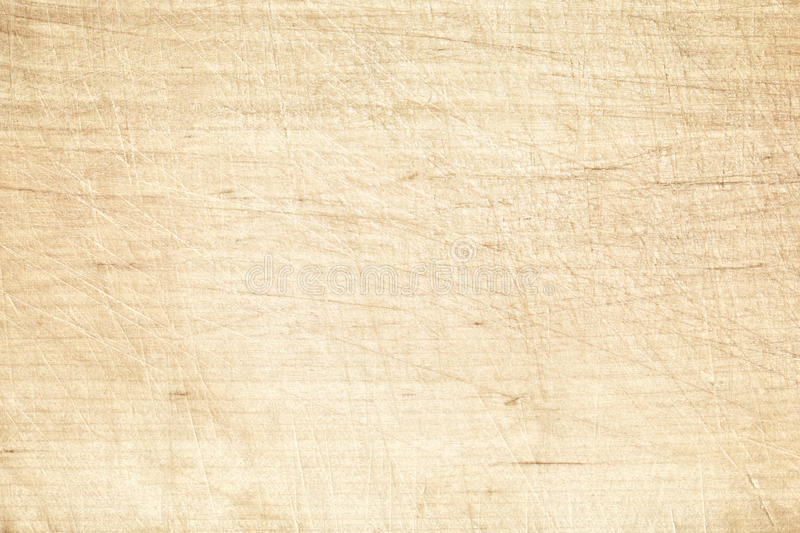 Light old scratched cutting board or wooden table royalty free stock photography