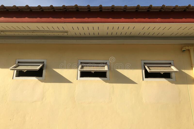 Low angle view of ventilator windows of toilet stock photography
