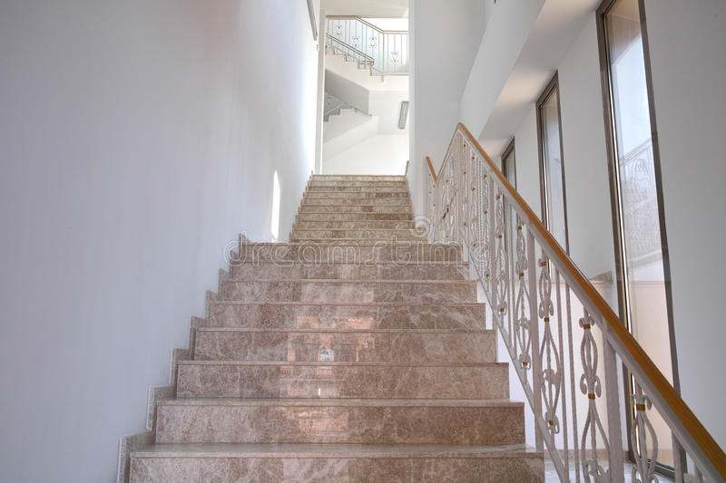 Stairs inside hotel. Brown marble stairs inside hotel stock image