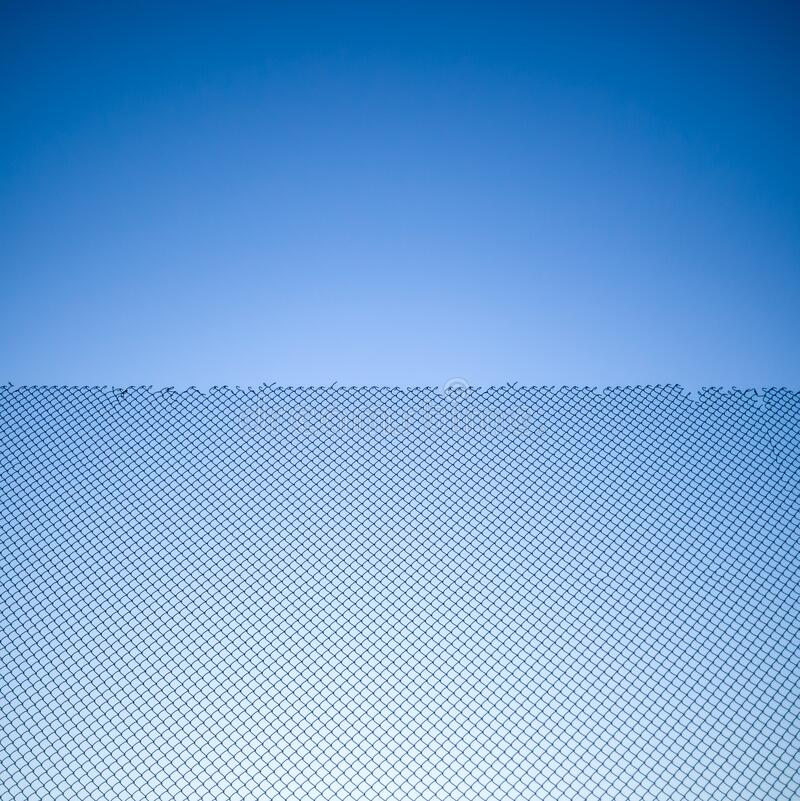 Mesh netting on blue sky background. Abstract background stock photo