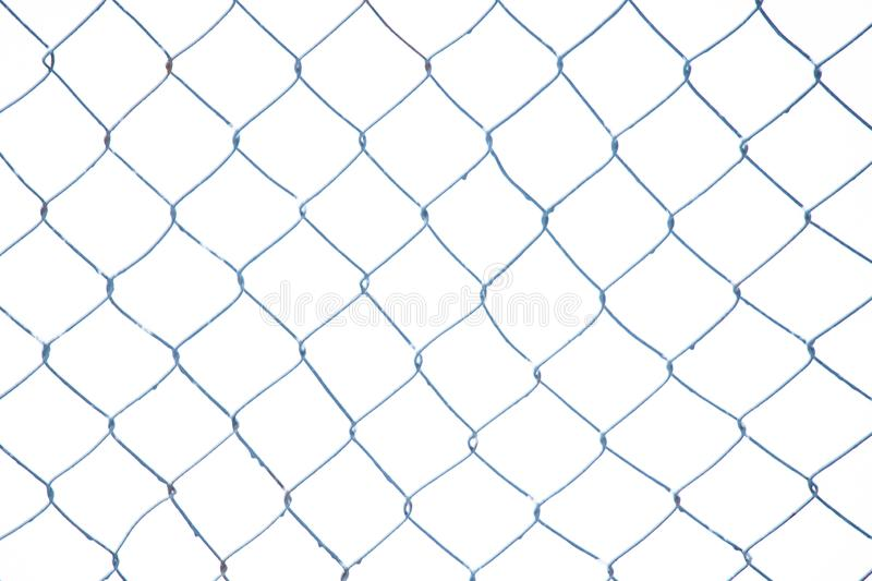 Mesh netting covered with snow. Winter industrial background.  royalty free stock photos