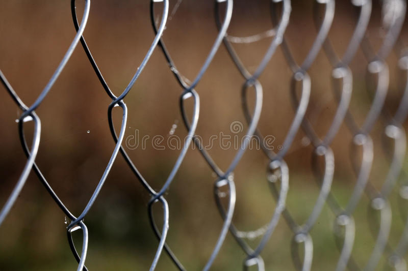 Mesh netting fence texture background. Mesh netting fence background texture stock photos