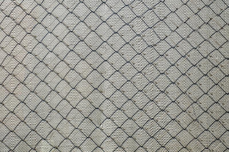 Mesh netting Rabitz. Casting shadow on polypropylene back tension surface stock image