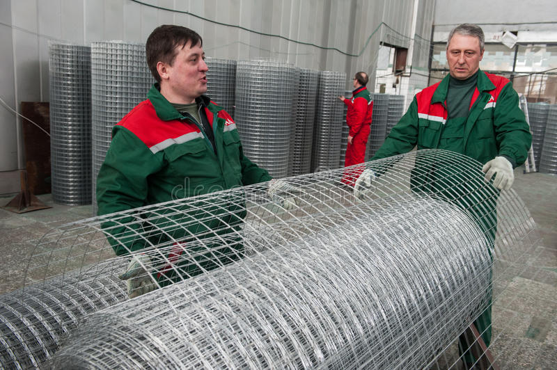 Mesh netting Warehouse. Leningrad, Russia - April 6, 2012: Plant for production of fences. Workshop packing wire mesh netting. Mesh netting in rolls royalty free stock image
